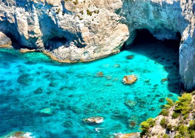 Panoramic view of Kryfo beach and caves in Keri, Zakynthos, Greece.